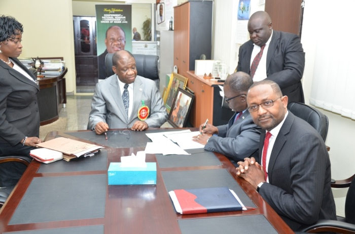 Ike Nwabuonwu, Chairman & CEO of Alpha Energy and Electric, Inc., Kansas City, Missouri, USA signing the MoU on December 16, 2014 for development of Rural Off-Grid Solar Electrification, Off-Grid (Embedded) and Grid-Connected Electricity in Nigeria