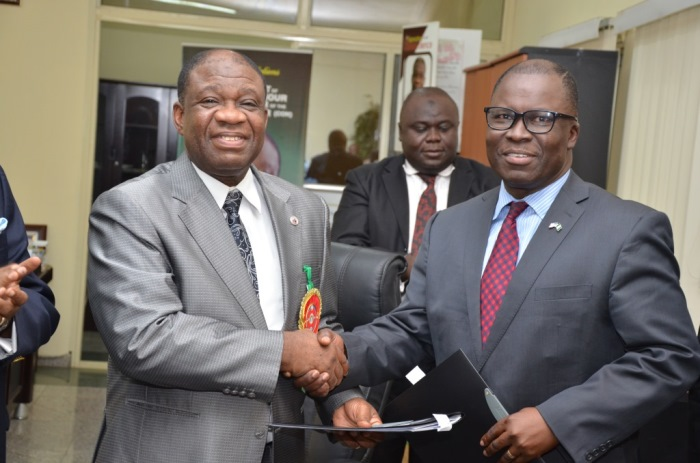 The Minister of Power, Chinedu Nebo (Professor) and Ike Nwabuonwu, Chairman & CEO of Alpha Energy & Electric, Inc. after signing the MoU on December 16, 2014 for development of Rural Off-Grid Solar Electrification, Off-Grid (Embedded) and Grid-Connected Electricity in Nigeria