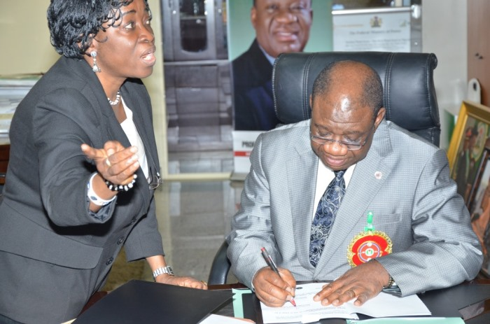 The Minister of Power, Chinedu Nebo (Professor) signing the MoU with a Alpha Energy and Electric, Inc., Kansas City, Missouri, USA on December 16, 2014 for development of Rural Off-Grid Solar Electrification, Off-Grid (Embedded) and Grid-Connected Electricity in Nigeria